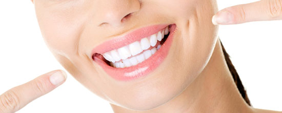 Woman showing her perfect straight white teeth.